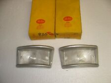 A pair of 1961-1967 Ford Econoline parking light lenses