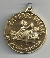 GIANT VINTAGE CAESARS PALACE LAS VEGAS NEVADA GOLD COLORED METAL MEDALLION