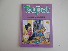 TOUPET T11 TBE EBRANLE LE SYSTEME