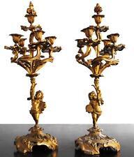 Paire de chandelier en bronze doré décor de putti