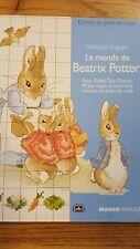 """livre """"le monde de Béatrix Potter"""" au point de croix"""