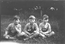 Original photo negative - Three young lads posing nicely on the grass.