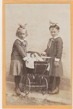 Real Photo Postcard RPPC - Two Glum Girls with Doll in Baby Buggy