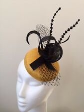 Stunning yellow round base fascinator with black sinamay loops and feathers!