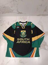 IIHF TACKLA SOUTH AFRICA GAME WORN USED BLACK JERSEY #9 BREMNER .
