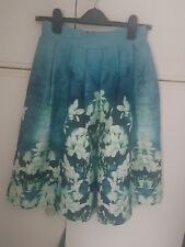 Beautiful handmade blue silk floral skirt with part elastic part zip waistband.