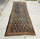 An Antique Runner Rug with Boteh Flowers