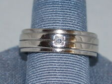 10k White gold ring with a diamond and a beautiful design-mens. It weighs 9.1 Gs