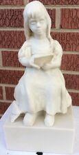 "E HEATH KING SCULPTURE FIRST LETTER  girl sitting resin 8"" also a book"