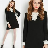Vintage 1960s go go MOD Black and White mini dress with Lace Collar and Cuffs