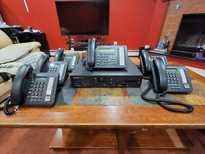 Complete phone system: 1Panasonic KX-NS700, 1 phone KX-DT543, 5 phones KX-DT521