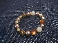 Very pretty elasticated beaded bracelet with various coloured beads lovely!