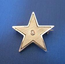 Spilla Stella a cinque punte in oro bianco 750/1000 con brillantino