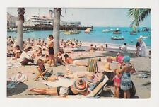 On The Beach at Avalon in Santa Catalina Island CA shows passenger ship & boats