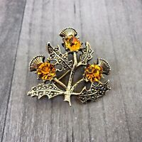 VINTAGE MIRACLE GOLD TONE SCOTTISH THISTLE ORANGE FACETED STONE BROOCH BADGE