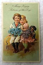 1909 HAPPY RETURNS POSTCARD CUTE BOY GIRL LITTLE DOG ON BENCH #K90