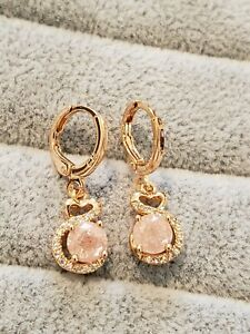 Perfect yellow gold plated light pink crystal heart swish design dangle earrings