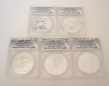 5 = 2011 ANACS 25TH ANNIVERSARY SILVER EAGLE SET FIRST DAY OF ISSUE ERROR HOLDER