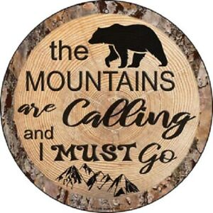 "THE MOUNTAINS ARE CALLING 12"" ROUND LIGHTWEIGHT METAL SIGN WOOD LOOK"