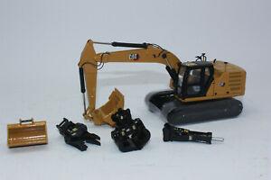 DM 85657 Diecast Masters CAT 323 Hydraulikbagger + Anbauteilen 1:50 Neu in OVP