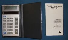 Texas Instruments TI-1767 Solar Calculator in wallet with instruction manual