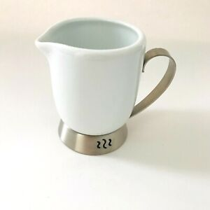 Creamer Bianca White by Trudeau Porcelain and stainless steel