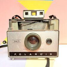 Tierra vintage Polaroid instantánea automático 320 Cámara usado estado