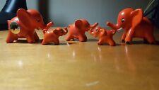 Goebel Walter Bosse elephant figurines, orange