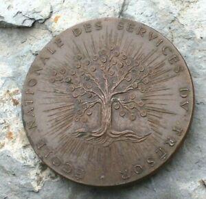 médaille bronze  école nationale des services du trésor ( signé d. ponce )