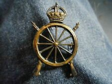 More details for unknown 'wheel and rifles' military badge