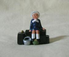 "Child sitting & waiting on luggage, 1-1/4"" train figure, Reproduction Johillco"