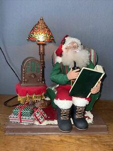 Trim a home Antimated Santa on a Chair with Radio and Lamp Music and Antimated