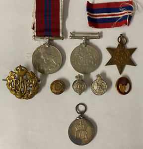 A Selection of Four Medals and Associated Badges