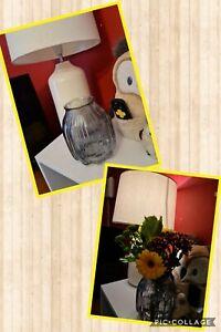 Glass vase for flowers, string lights