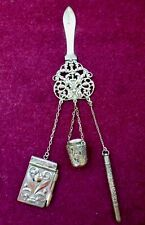 ANTIQUE CHATELAINE, THIMBLE HOLDER WITH THIMBLE, NOTEBOOK, AND PROPELLING PENCIL