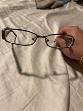 Prada Eyeglasses Frames:  VPR 58L 5AV-101. Purple & Silver. 51-14-135.