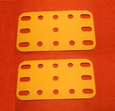 Two yellow Meccano plastic plates, part 194