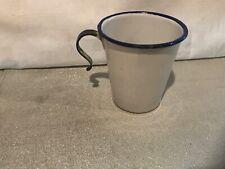 VINTAGE WHITE ENAMELWARE COFFEE CUP WITH BLUE ENAMEL TRIM AND HOOK HANDLE