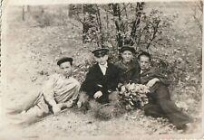 Teen boys lying on grass school uniform Soviet Russian vintage photo