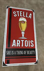 """Stella Artois Metal Beer Sign Large 32""""x 17"""" She Is A Thing Of Beauty ~ Embossed"""