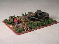 HO Scale Man loading firewood on his pickup truck.