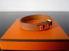 HERMES : Bracelet cuir et plaqué or.
