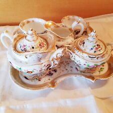Service à thé en porcelaine de Paris à décor floral polychrome