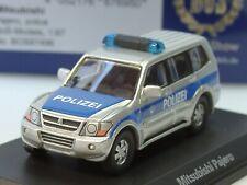 BOS Mitsubishi Pajero POLIZEI, blau-silber - 87496 - 1:87
