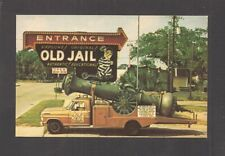 POSTCARD:  THE OLD JAIL ENTRANCE SIGN & CANNON TRUCK - ST. AUGUSTINE, FLORIDA
