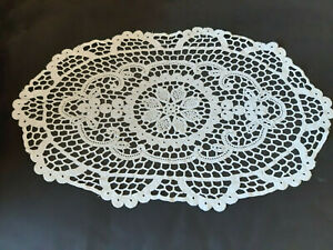 Vintage white oval shaped crocheted cloth.