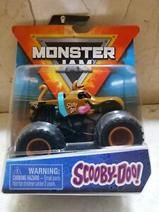 MONSTER JAM SCOOBY DOO IMPORT USA SCOOBY-DOO! ESCALA HOT WHEELS PULSERA D REGALO