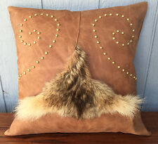 Handmade coyote fur and leather pillow with swirl studs