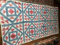 antique quilt on the early red and cream and blue