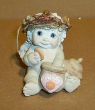 "Dreamsicle Figurine, ""Eating A Cookie"""